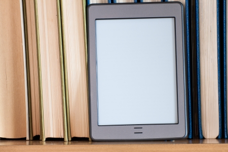 ereader placed on the books of a library Stock Photo - 17405724