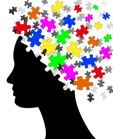 head toy: illustration of silhouette head with colorful pieces of puzzle