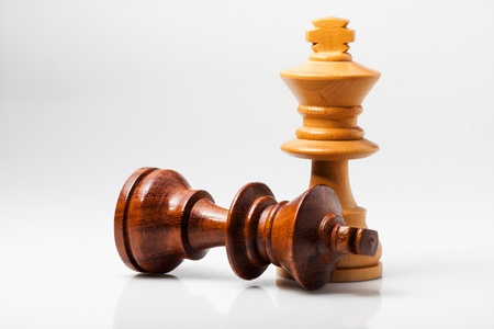 loss leader: photo of two king of chess with white background