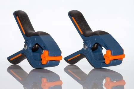 clamped: photo close up of blue and orange clamp