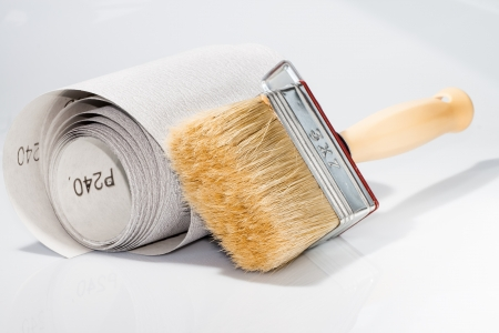 sanding block: photography of paint brush and sandpaper for work