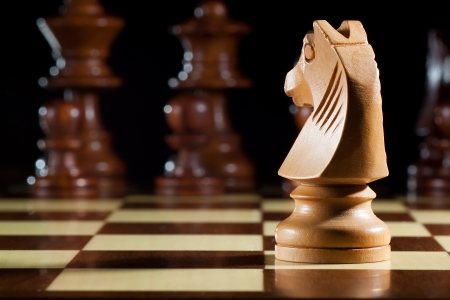 photo of white knight chess on chessboard for game Stock Photo