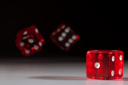 a pair of: photo of red dice with black background