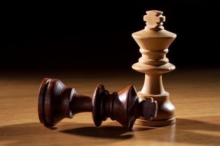 beat the competition: photography ok white and black king chess on table Stock Photo