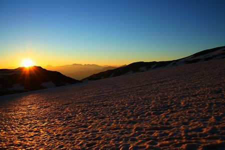 vastness: beautiful sunrise on the glacier of saint sorlin (French Alps) Stock Photo