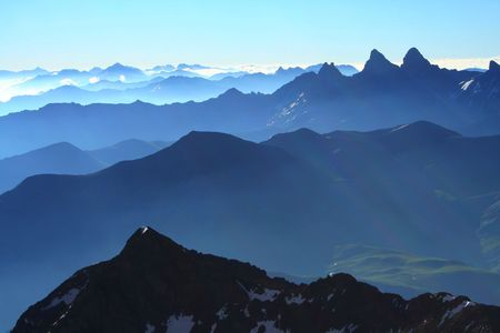 succession: Succession of peaks in the alps with a very good light