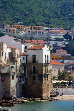 sicilian: Sicilian houses in front of the sea (italy). The beach of cefalu.