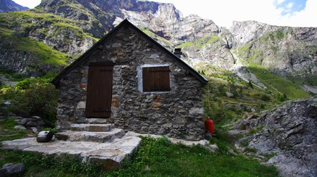 old chalet or refuge in mountains photo