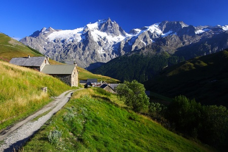 hamlet: Small rural hamlet and Meije peak landscape in oisans by a sunny summer day.