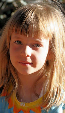 Portrait of a young girl with the late afternoon sun shining on her face Stock Photo