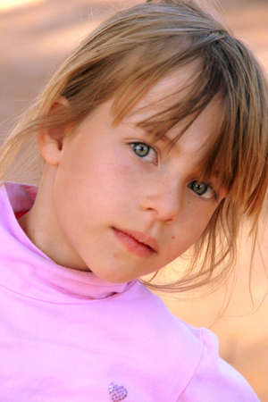 Portrait of a girl wearing a pink polo neck top