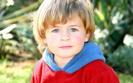 Portrait of a little boy in the garden