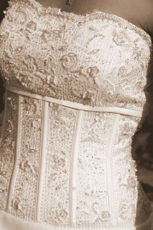 Portrait of a wedding dress in sepia format Stock Photo