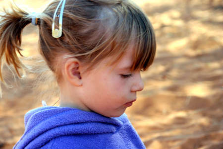 Portrait of a girl playing outdoors in the sand
