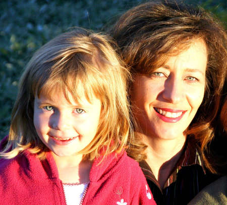 portrait of a mother and daughter, afternoon sun in the garden