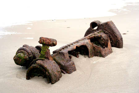 Portrait of a part of  a shipwreck lying on the beach