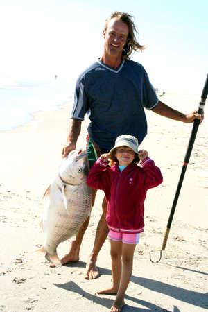 Portrait of a man and his daughter with  a big fish Stock Photo