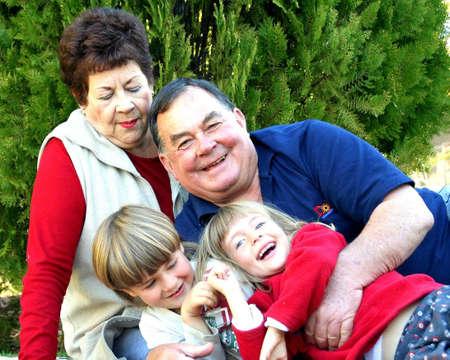Portrait of grandparents with grandchildren sitting in the garden