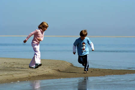 Portrait of two children playing at a lagoon