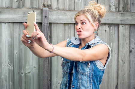 Woman making funny selfie