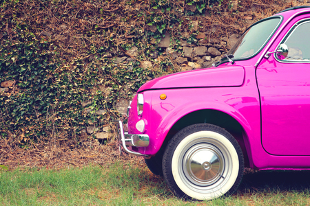 Pink car parked on sideroad