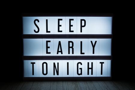 Sleep early tonight text in lightbox Reklamní fotografie