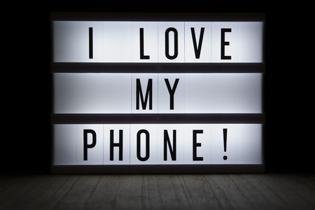 I love my phone text in lightbox Reklamní fotografie