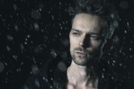 Handsome man in the snow Reklamní fotografie