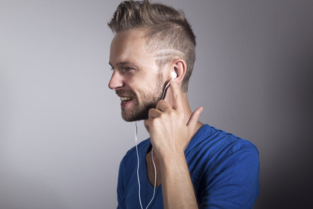 Man smiling and listening to music