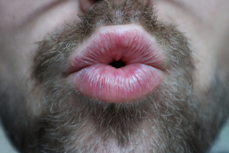 Man with facial hair giving kiss Stock fotó