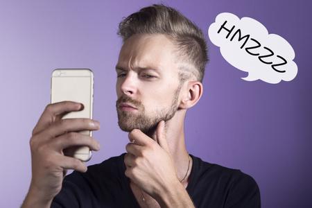 Man looking akward at his mobile phone