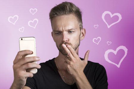 Man making a kissing picture selfie