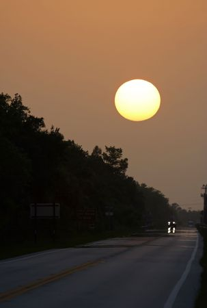 The sun sets over the historic Tamiami Trail, Big Cypress National Preserve Stock Photo - 7451615