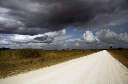 Dark Clouds over Wagon Wheel Road, Big Cypress National Preserve Stock Photo