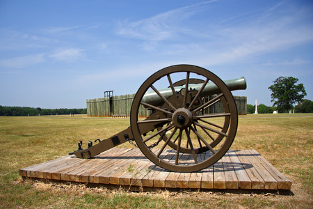 andersonville: Artillery piece with prison stockade in distant background, Andersonville National Historic Site, Georgia