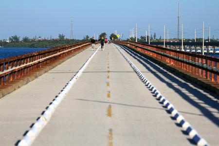 mile: Hikers trek along the old Seven Mile Bridge in Pigeon Key State Par, Florida Keys