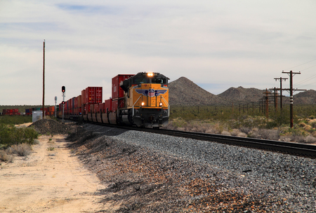 MOJAVE NATIONAL PRESERVE, CA - MARCH 27: A Union Pacific freight train traverses the vast California desert March 27, 2016 in Mojave National Preserve, CA