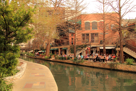 Riverwalk, with its numerous hotels and restaurants, is a prime destination for locals and for tourists visiting historic San Antonio February 27, 2017 in San Antonio, TX Editorial