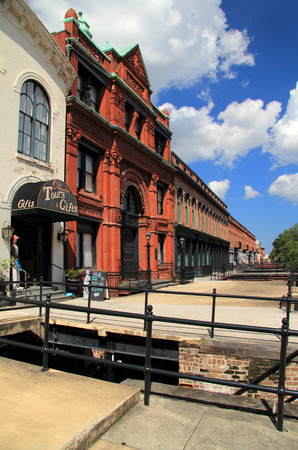plied: SAVANNAH, GA - JULY 22: Once a key site where cotton merchants plied their trade, Factors Walk now hosts numerous shops, restaurants, and hotels in the city of Savannah July 22, 2017 in Savannah, GA