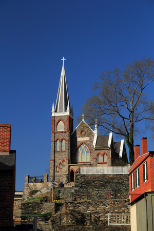 The steeple of St Peters Roman Catholic Church rises high above the historic town of Harpers Ferry, West Virginia, made famous by John Brown's failed attempt to incite a major slave rebellion in 1859 Stock fotó