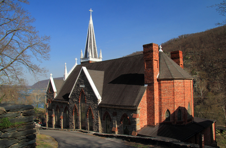 The steeple of St Peters Roman Catholic Church rises high above the historic town of Harpers Ferry, West Virginia