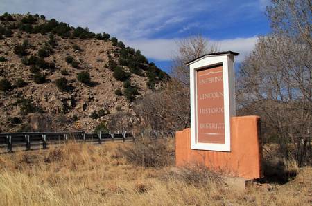 A sign along the roadside welcomes visitors to the historic town of Lincoln, New Mexico, site of the famous Lincoln County War