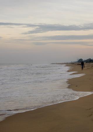 Walk at the beach on the sunrise