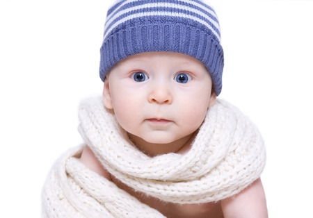 the little boy in a blue cap and a white scarf photo