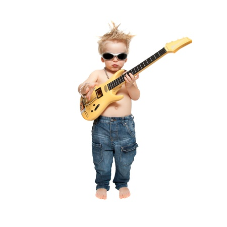 the boy in sunglasses plays an electric guitar photo