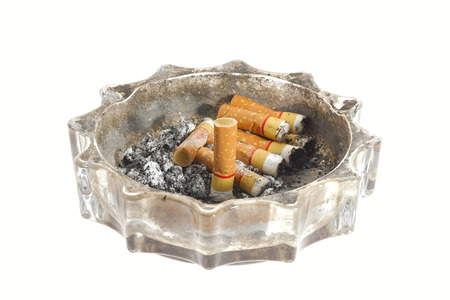 Dirty ashtray with cigarette on white . photo
