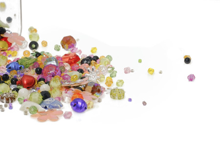 Colorful beads isolated on white background. photo