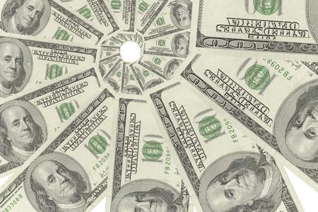 transfer pricing: Swirl of hundred-dollar bills on white background.