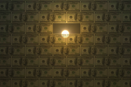 transfer pricing: Sun rise behind wall of money.