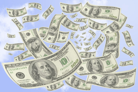 transfer pricing: Hundred-dollar bills falling from the sky. Stock Photo